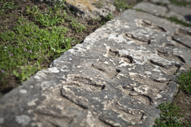 """A stone carving that says """"Erastus with his own finances paved this road."""""""